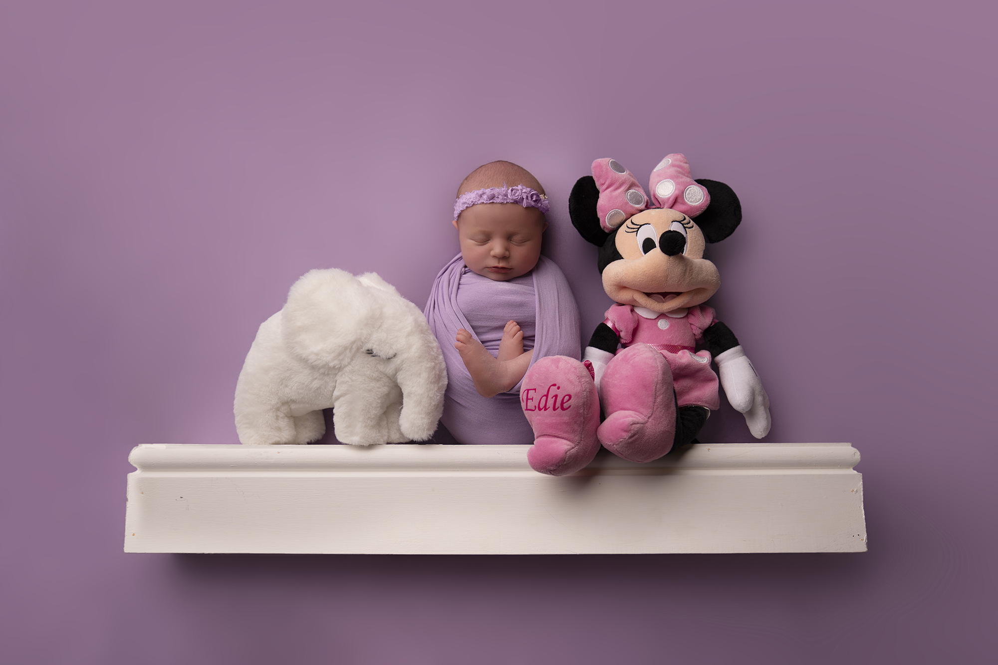 Newborn baby and Minnie Mouse